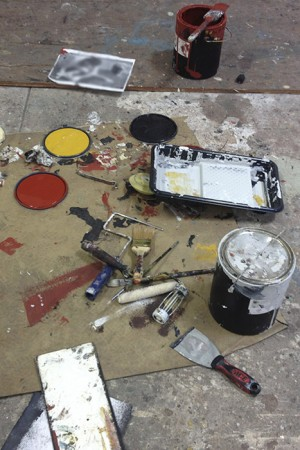 Barbara Downs' studio floor with a mess of painting supplies