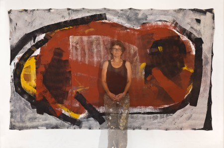 Original artwork by Barbara Downs, Barbara Downs standing in front of Inward, Acrylic/Mixed-Media on Unstretched Canvas
