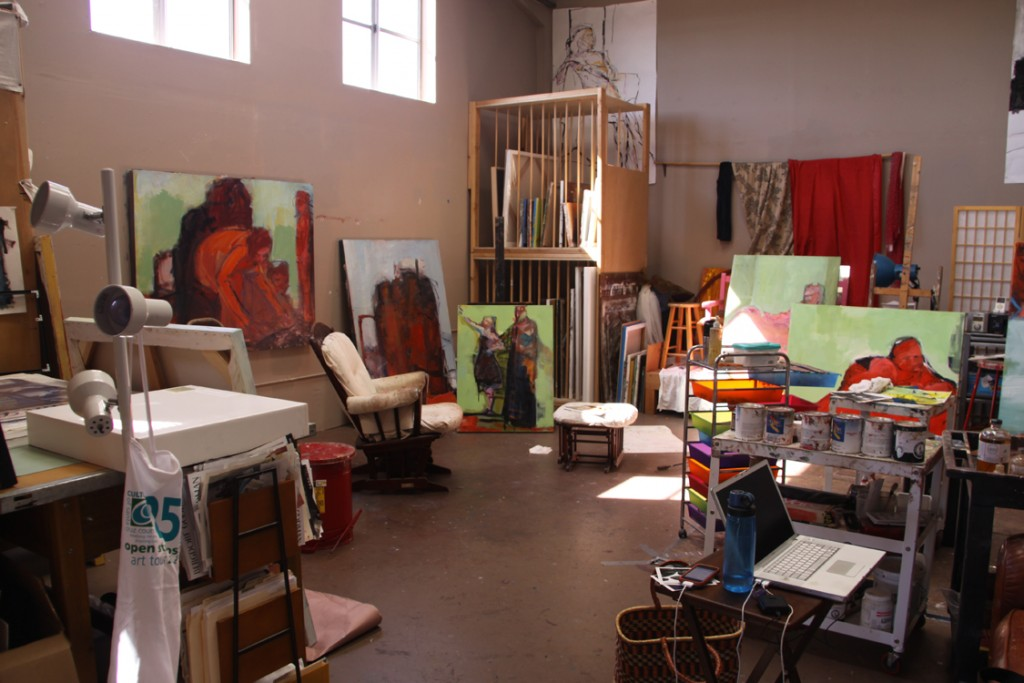 Barbara Downs' studio with many paintings out