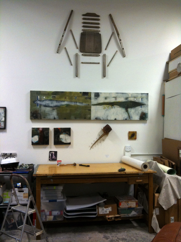 Original artwork by Barbara Downs, encaustic and sculpture on the studio wall