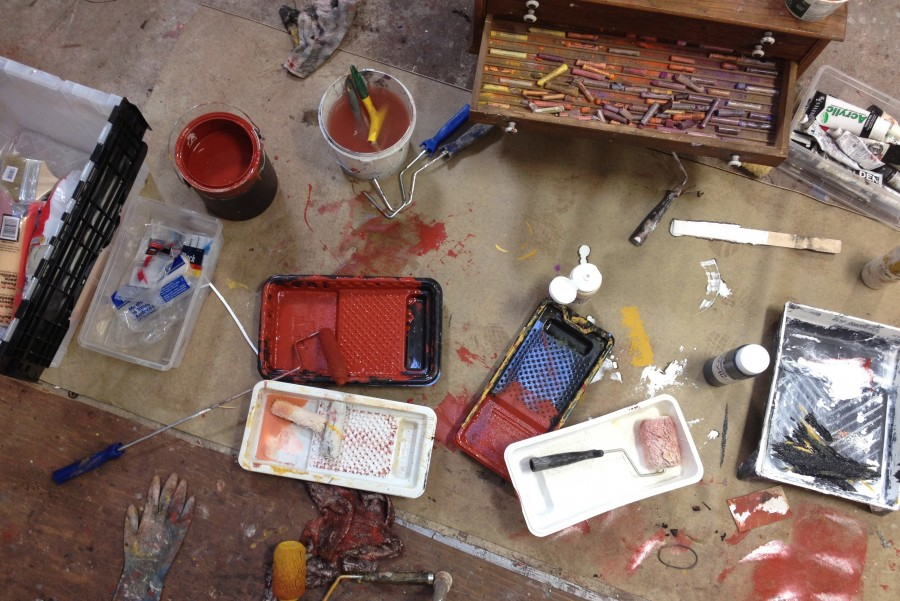 Photo of the studio floor of Barbara Downs showing paints and drawing materials
