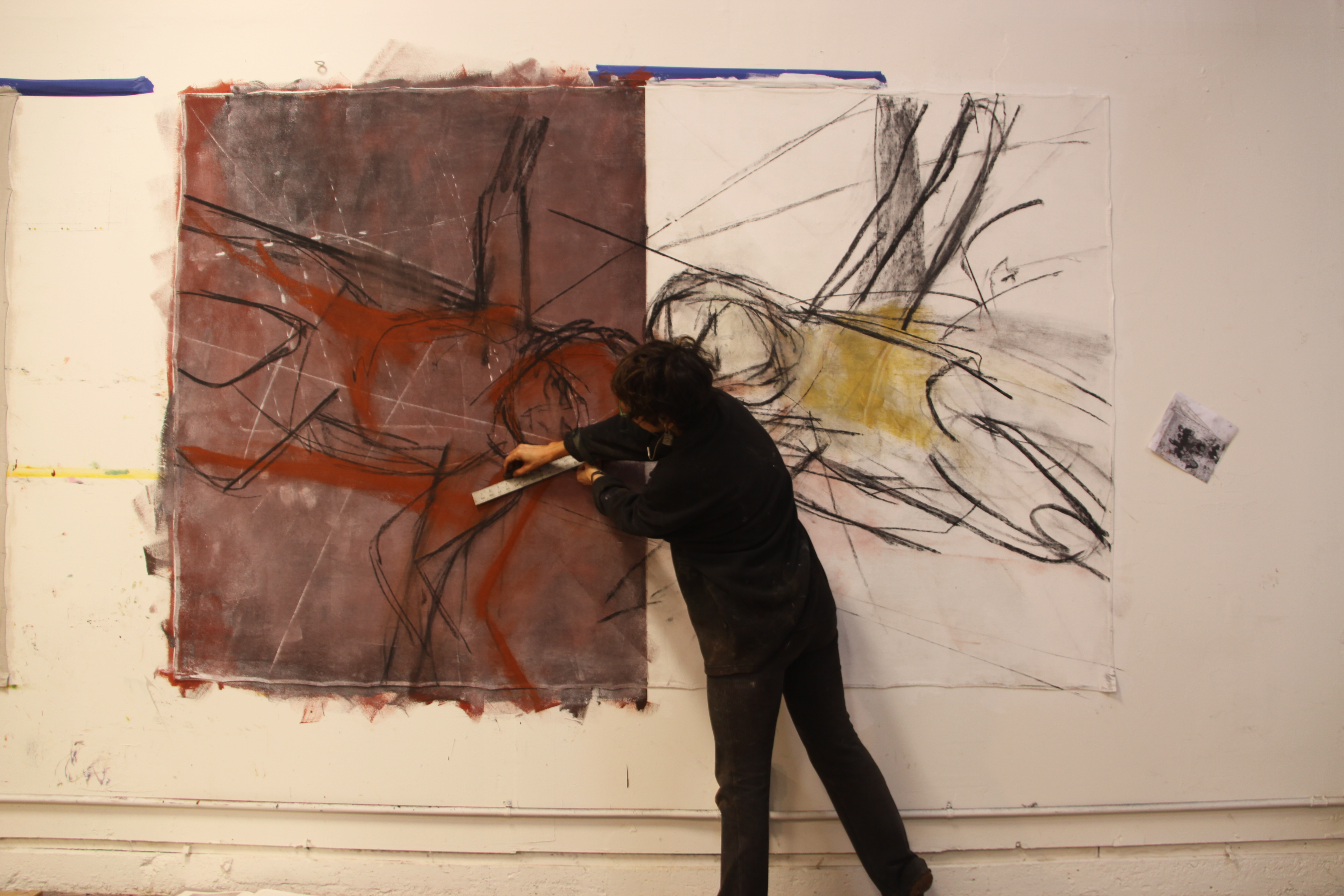 Barbara Downs painting a large-scale painting in her studio