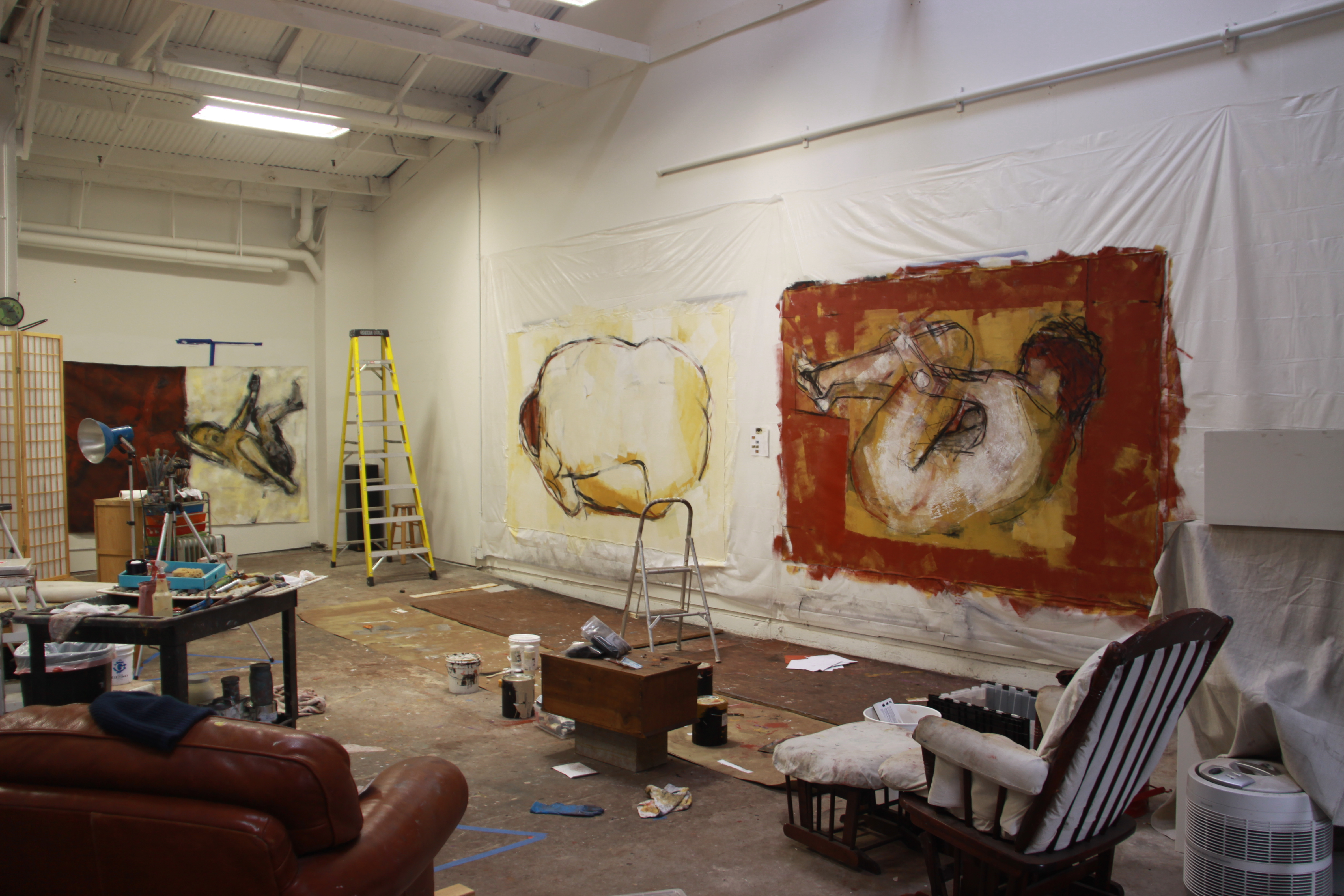Large-scale paintings hanging in the studio of Barbara Downs