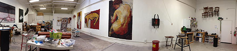 The studio of  Barbara Downs with large-scale figurative paintings and other artwork